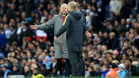 Manchester City manager Pep Guardiola (right) and Arsenal manager Arsene Wenger (left) argue on the