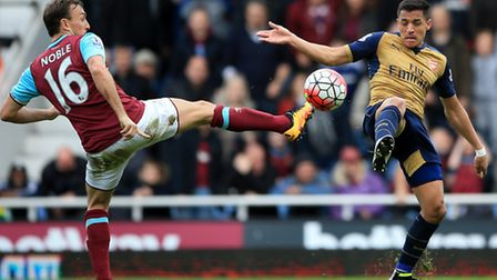 West Ham United's Mark Noble and Arsenal's Alexis Sanchez battle for the ball during the 3-3 draw be