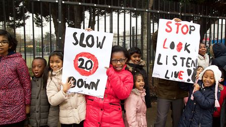 Sudbury Primary School pupils made posters after three children run over outside their building Pic: