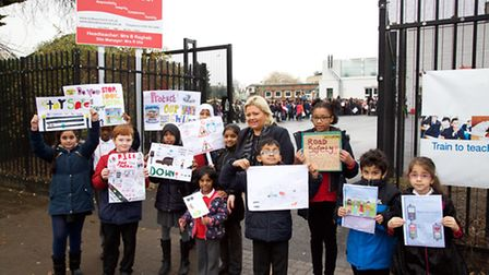 Beth Ragheb headteacher at Sudbury Primary School with pupils against traffic - Walking Bus protest