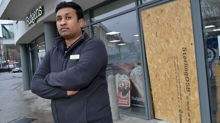Naveen Kumar, manager of Budgens in Packington Square, outside the store after Tuesday's attempted b