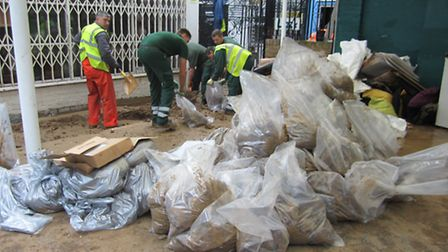 Hundreds of bags of flood debris have been cleared away
