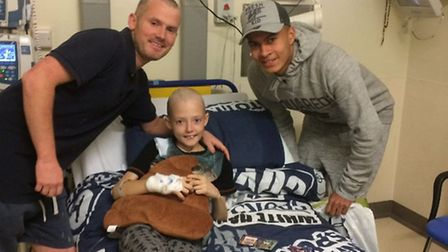 Tony Clark, 11, with his dad Anthony and Tottenham footballer Dele Alli. Picture: Family of Tony Cla
