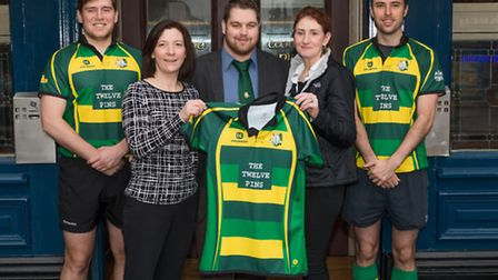 Finsbury Park RFC players display their new kit, courtesy of their sponsors, The Twelve Pins.