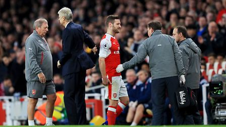 Arsenal's Shkodran Mustafi leaves the field with an injury during the Premier League match at the Em