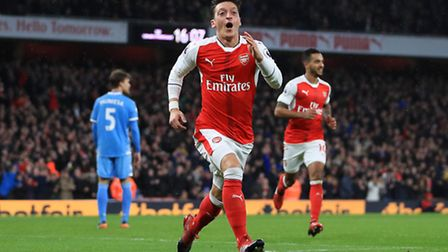 Arsenal's Mesut Ozil celebrates scoring his side's second goal during the Premier League match at th