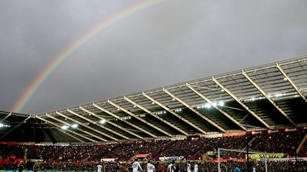 A rainbow is visible in the sky during the Premier League match at the Liberty Stadium, Swansea.