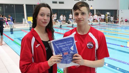 Anaconda Swimming Club captains Elena Dewhurst and Tommy Donovan with the club's National Arena Leag