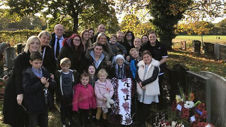 Peggy Liddiard's family at the grave of her husband, Bill. Picture: Peggy Liddiard family