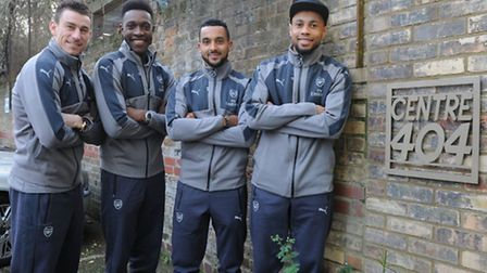 Arsenal players outside Centre 404 in Holloway last month. It is one of six charities to benefit fro