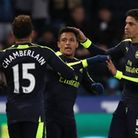 Arsenal's Alexis Sanchez (centre) celebrates scoring his side's fourth goal of the game during the P