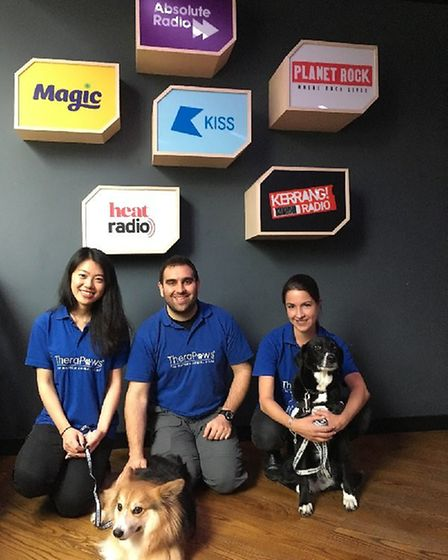 Helen with Java, Therapaw manager Luke and Nathania with Chloe at Bauer Radio on Blue Monday