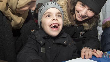 A family at the sixth annual Menorah lighting festival in Islington Green last night. Picture: John