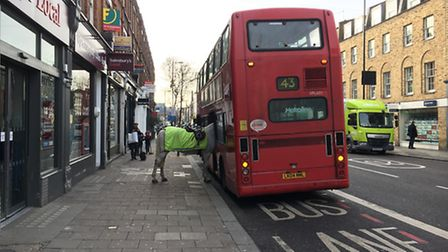 A police horse gets on the 43 bus in Upper Street, Islington. Picture: Simon Crowcroft