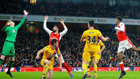 Alex Iwobi (right) heads Arsenal's second goal in the 2-0 win over Crystal Palace