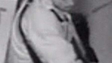 CCTV still of man who raided Budgens, Packington Square on December 11 (Picture: Met Police)