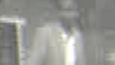A CCTV still of the man police wish to speak with.