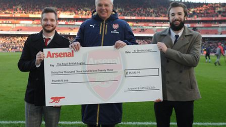 Arsenal chairman Sir Chips Keswick presents a �35k cheque to the Royal British Legion before the Emi