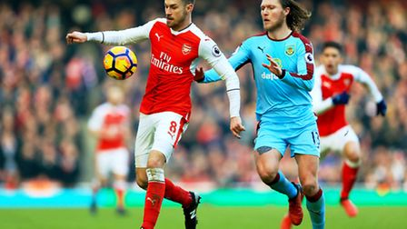Aaron Ramsey (left) shields the ball from Burnley's Jeff Hendrick during Arsenal's 2-1 win at the Em