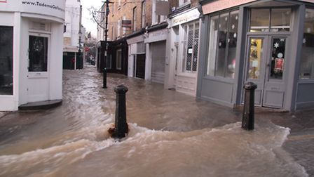 Water poured down Upper Street after a burst water main in December.