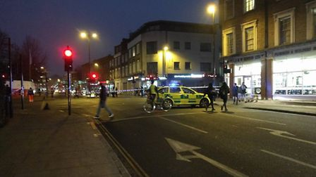 Police in Balls Pond Road on Wednesday night. Picture: Daniel Gould