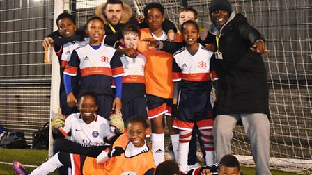 Essex Road Giants FC with coaches Lewis Yeboah (back row, right) and Ryan Hassan