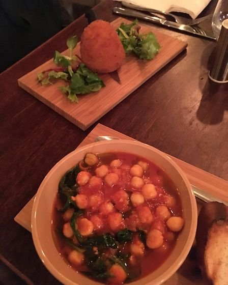 La Taberna starters: rice ball and spinach and chickpea soup. Picture: James Morris