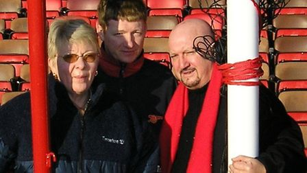 Darren Marsh's family: mum Daphne, brother Kevin and dad Terry lay flowers at Highbury Stadium in 20