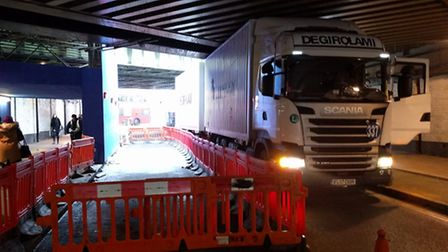 This lorry got temporarily stuck under the bridge while going the wrong way.