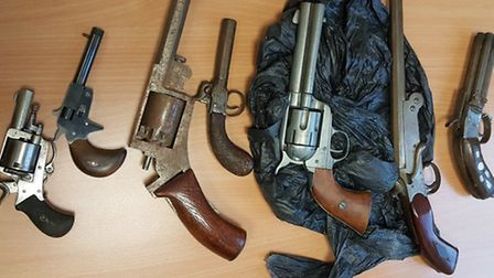Seven of the eight guns handed in to Islington Police in a firearms amnesty. Picture: Islington MPS/