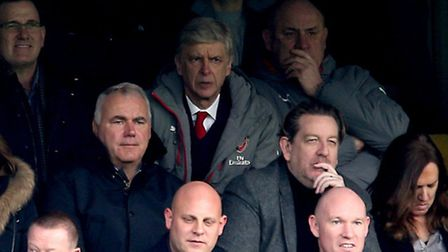 Arsenal manager Arsene Wenger looks on from the stands at Stamford Bridge during his side's loss to