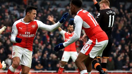 Arsenal's Alexis Sanchez (centre) celebrates scoring his side's first goal of the game