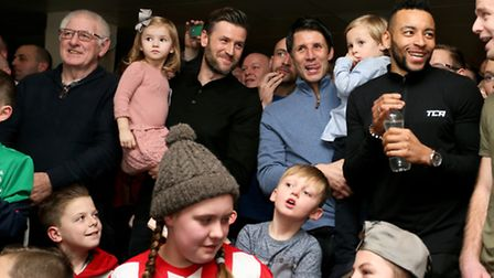 Lincoln City manager Danny Cowley and assistant Nicky watch the FA Cup quarter-final draw with fans