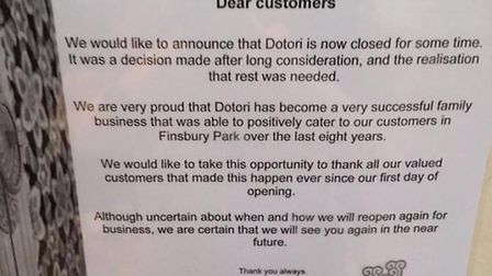 This sign was pinned to the restaurant door announcing its closure