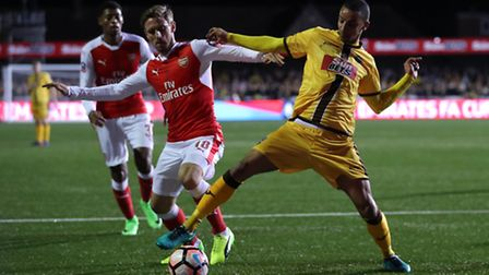 Sutton's Craig Eastmond goes down under a challenge in the box from Arsenal's Nacho Monreal (pic And
