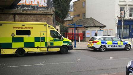 Police and paramedics under the Cally Road bridge on Tuesday. Picture: James Morris