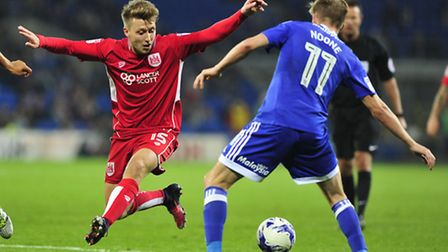 Luke Freeman (left) has completed his �300,000 move to QPR from Championship rivals Bristol City. (P