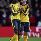 Arsenal's Danny Welbeck celebrates scoring his side's second goal of the game with teammate Arsenal'