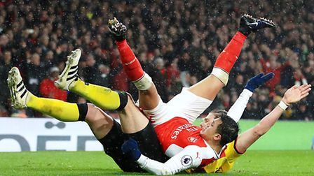 Alexis Sanchez tussles with Watford's Sebastian Prodl during Arsenal's 2-1 defeat on Tuesday