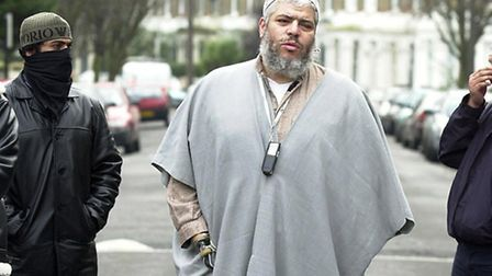 Abu Hamza preaching outside Finsbury Park Mosque in 2003. The cleric was accused of abusing his posi
