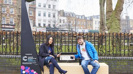 Cllr Claudia Webbe tests out the new Smartbench near Islington Green. Picture: Simon Way