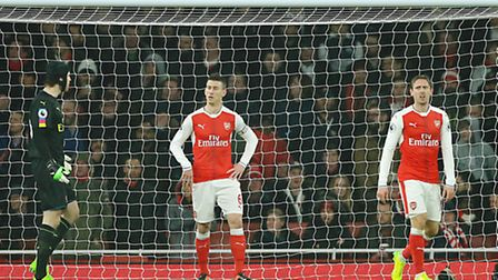 The anguish shows on the faces of Arsenal players (l-r) Petr Cech, Laurent Koscielny and Nacho Monre