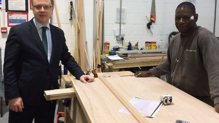 Cllr Richard Watts at Islington's housing repairs centre, where doors are made exclusively for counc