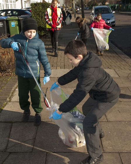 Roe Green Junior School students litter picking in the streets around Kingsbury.