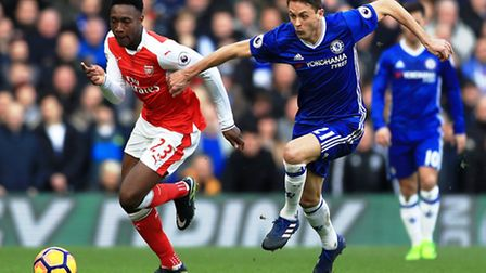 Arsenal substitute Danny Welbeck (left) battles for the ball with Chelsea's Nemanja Matic