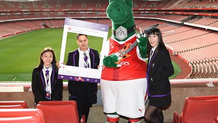 Artela, Renea and Ella with Gunnersaurus at Emirates Stadium. Picture: Daniel Hambury