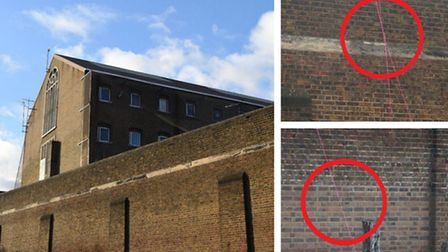Lines of bright pink rope (circled) can be seen dangling over the walls of Pentonville prison this m