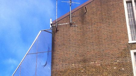 Holes in the perimeter netting at Pentonville prison in November. Prison authorities say the nets ha