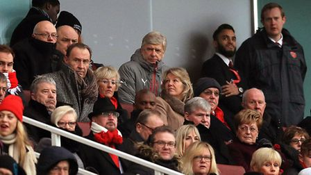 Arsenal manager Arsene Wenger watches the action from the stands during the Premier League match at