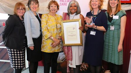 The team with their award at the House of Lords. Lourdes Colclough (holding the award) and Kathy Wil